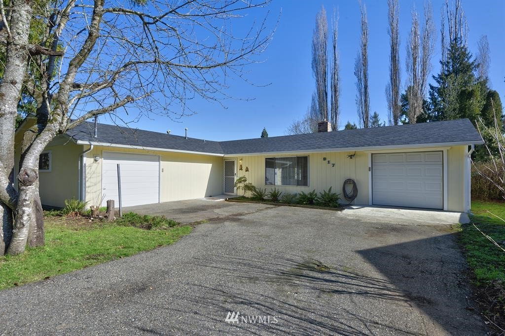 If you love blueberries, then you're going to love this charming rambler sitting on a shy half acre, complete w/ mature blueberry bushes! This property was once part of Bond's Blueberry Farm. Sporting a new roof, new tile flooring & new carpet throughout, this spacious 2112/sf, 3 bd, 1.5 bath rambler has space for everyone! Privacy & room to roam await you in the large fenced back yard, complete w/ a darling bungalow! Great location close to Highways, the Sounder station, the Fairgrounds & more!