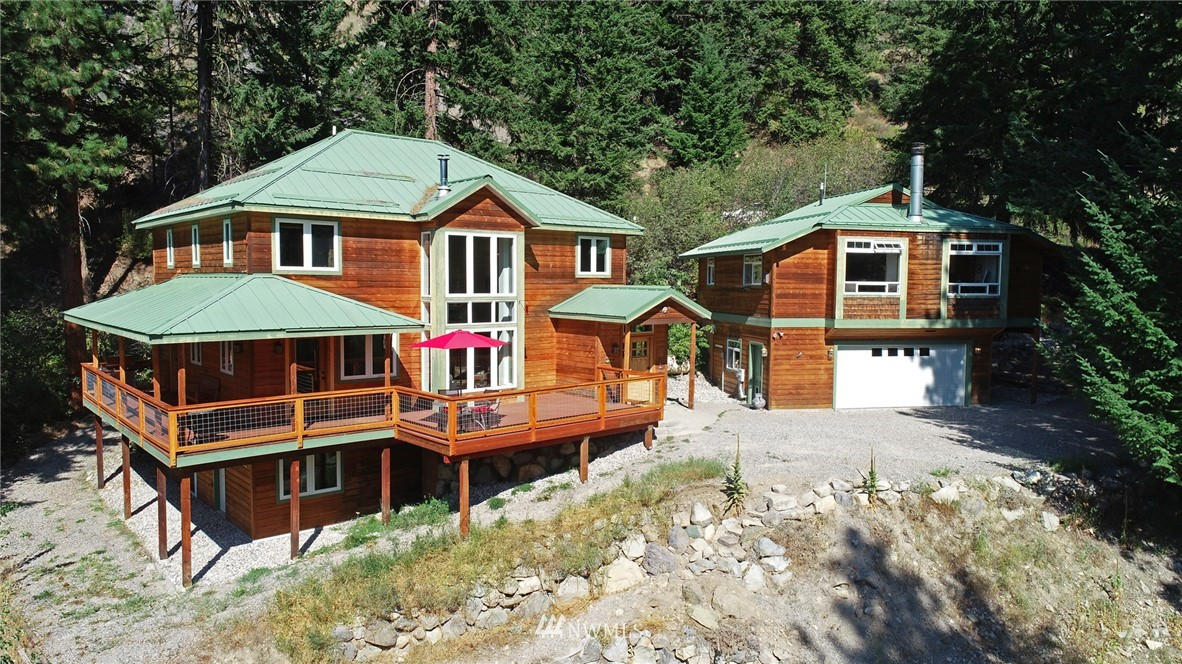 Desirable mountain lover's location! New open floorplan, distinctive use of tile in deluxe renovated bathrooms, fresh pine trim. Enjoy beautiful sunsets & fabulous mountain views from wide deck & lg living rm windows!Spacious home for multiple activities & many guests! Choice ensuite master bedroom, 2 bdrms, several flex rms/offices, basement guest rm. Oversized 2 car garage provides space for mountain gear & Sweet Studio above w views. Close to Mazama & Edelweiss neighborhood trail connections.