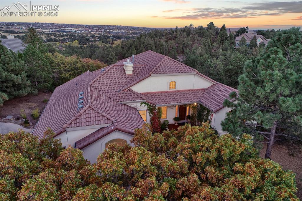 Tucked privately amongst the trees and perched at the end of a cul-de-sac in Woodmen Oaks with stunning city views, this immaculate and expertly appointed  custom ranch style home offers a light, bright & open floor-plan coupled with wonderful outdoor living spaces - don't miss this one! The ML office/study/bedroom offers a quiet space for your work-at-home needs. Hardwood floors flow throughout the main level. The open great room has fireplace, built-ins and access to the composite, covered deck. The adjacent dining area also opens to the inviting outdoor deck. The gourmet kitchen offers a walk-in pantry, granite counters, tile backsplash, stainless steel appliances including gas cooktop/range, built-in microwave into the island w/counter seating and dishwasher. Custom refrigerator matches the cabinets. Enjoy the views from the expansive, vaulted master bedroom with walkout. The spa-like 5pc master bath includes a large dual sink vanity, jetted tub, separate shower & walk-in closet. A 3/4 bath and the laundry room with sink, window & storage complete the main level. The walkout basement provides additional entertaining space in the large rec room with fireplace, built-ins, wet bar and walkout to the covered patio. The versatile flex space with closet could be an exercise room/hobby room/studio. Three secondary bedrooms, a ¾ and full bath along with plenty of storage completes this level. Interior features include a whole house humidifier, arched walkways & high ceilings. Sit outside on your composite deck or under the Pergola from the main level and take in the city views all year-round. The natural landscaping lends to lower maintenance upkeep outdoors. Located in esteemed School District 20, close to Woodmen Roberts Elementary School, with neighborhood access to the Sante Fe Trail for beautiful scenery, hiking & biking and with easy access to I-25 for commuting anywhere in the Springs or Denver, you won't want to miss this home!