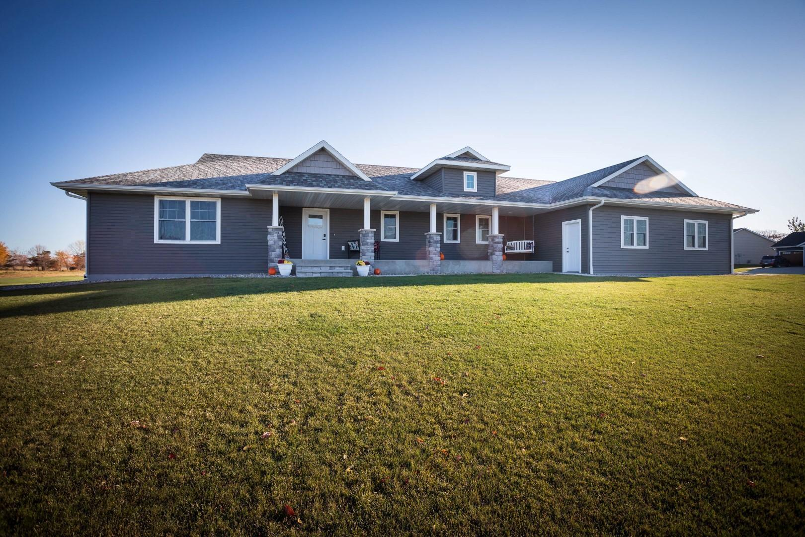 Do you recognize this STUNNING home from the 2019 Parade of Homes? Was it a dream that you wanted to become a reality? Here it is!  This 2 year old 4BR, 4BA rambler gives the WOW factor immediately when you walk in as you see the beautiful custom Black Walnut cabinets and trim! Offering all the desirables, this home is sure to check all your boxes: Bright/Open floor plan with a gorgeous kitchen, granite throughout, gas fireplace, spacious owners suite with tiled shower and double sinks, main floor laundry, all bedrooms offer walk-in closets,  14X15 maintenance free deck, 3 stall attached insulated and heated garage situated on ½ acre corner lot and close to bike trail, downtown shopping and quick jaunt to the interstate and so much more! Downstairs is where more entertaining can happen-family room and rec area along with 2 additional very large bedrooms. This one is going to go quick, don't miss your opportunity for a shot at it!