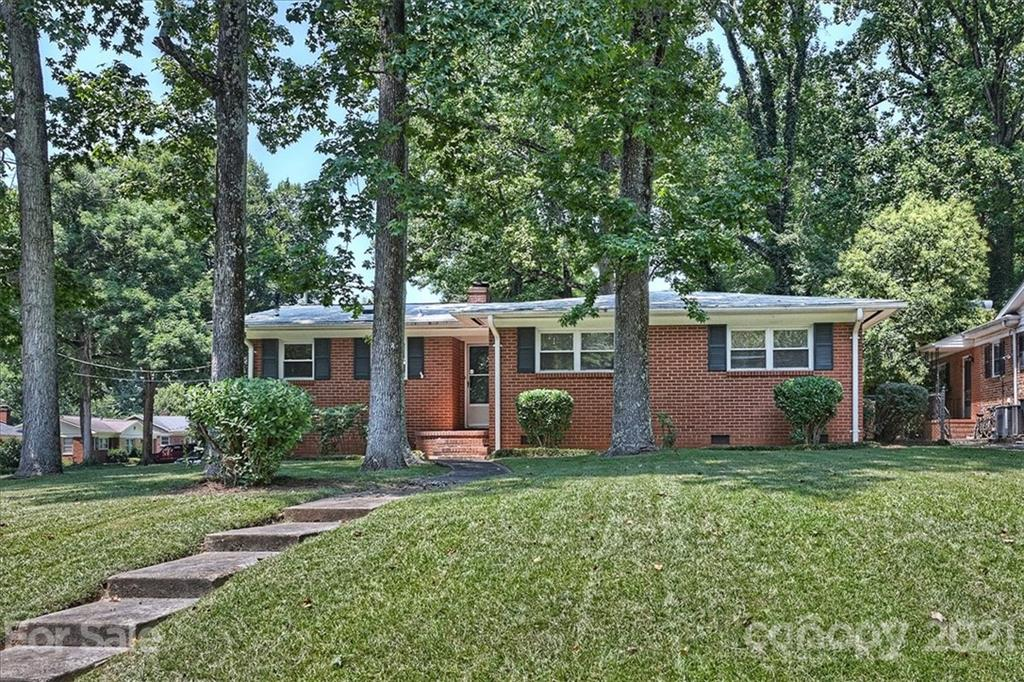 CUTE brick ranch home in up-and-coming Amity Gardens with beautiful vintage hardwood floors, modern (insulated) windows, and fenced yard.