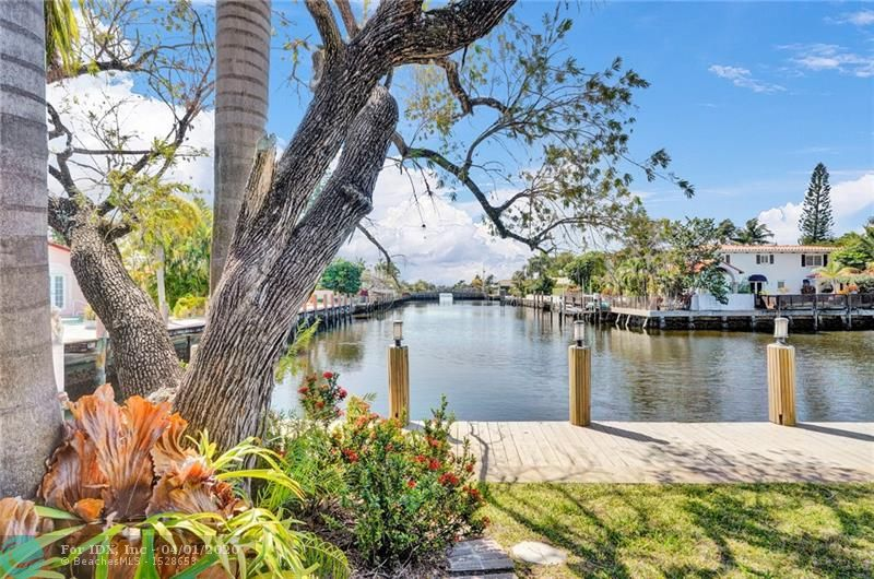 **CONTACT ME TO SCHEDULE YOUR PRIVATE BY APPOINTMENT LIVE OR VIRTUAL SHOWING**  EAST OF FEDERAL OFF BAYVIEW DRIVE Classic Fort Lauderdale expanded ranch style home on a WIDE CANAL turning basin. Sweeping views down the canal the moment you open the front door! 3 bedrooms, 3 full baths, Formal Dining Room PLUS separate den! HUGE recently remodeled kitchen with solid wood cabinets, creme d' Anjou granite, stainless steel appliances & sliding doors that open onto the heated pool with waterfall which is PERFECT for effortless year round outdoor entertaining.  Oversized 2 car garage and separate laundry room with newer washer & dryer. Porcelain tile floors in all public rooms. Bahama shutters throughout. Recently replaced A/C & pool heater as well. Low ball offers will not be responded to.