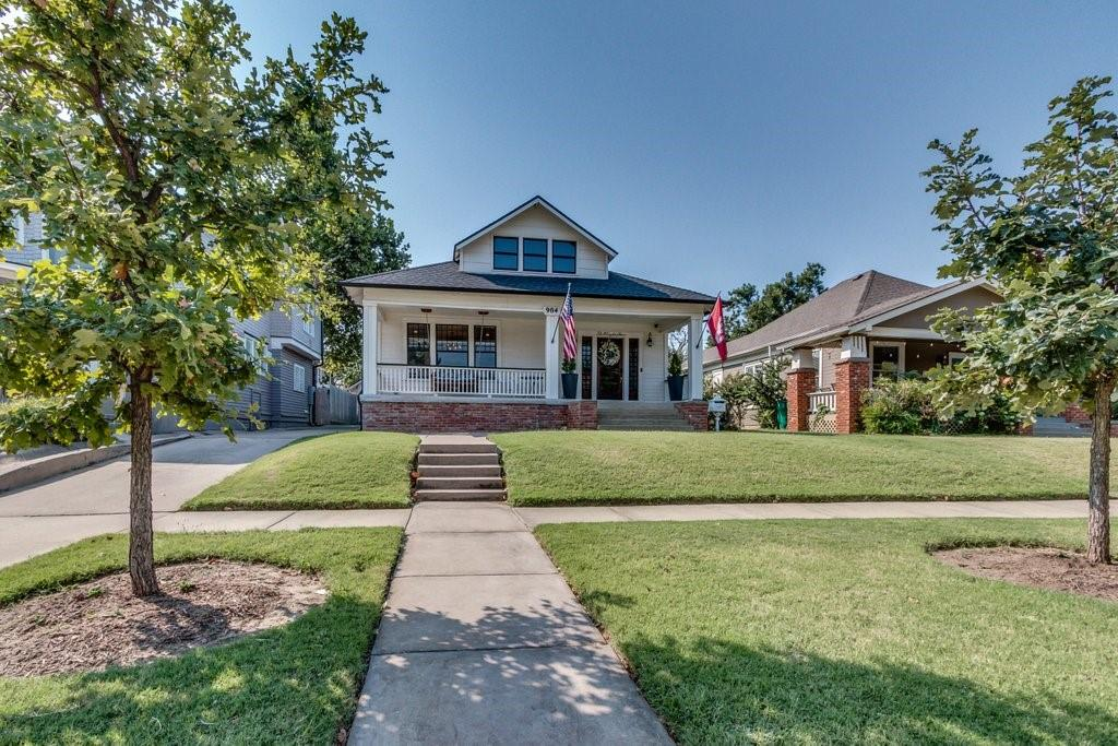 YOU DO NOT WANT TO MISS this stunning Mesta Park remodeled Bungalow! Just minutes from downtown, Midtown and Uptown, this beauty has been completely renovated with no detail overlooked. This home features an open floor plan with original hard wood floors, rebuilt 100 year old windows and wonderful woodwork. The kitchen features Quartz countertops, custom cabinets, state of the art stainless appliances and Carrara backsplash. The primary bath has a dual vanity with custom cabinets and a gorgeous oversized walk in shower. The guest bedroom features large windows and a modern, clean lined full bathroom with dual vanity and tub. There is also a half bath located on the main level. The third bedroom is upstairs, with a built-in bed and cabinets. The room attached to the 3 car tandem garage is finished with a heating and cooling system and would make a great bonus room, gym, or office. This home has TONS of natural light. Don't miss this chance to live in the heart of OKC!
