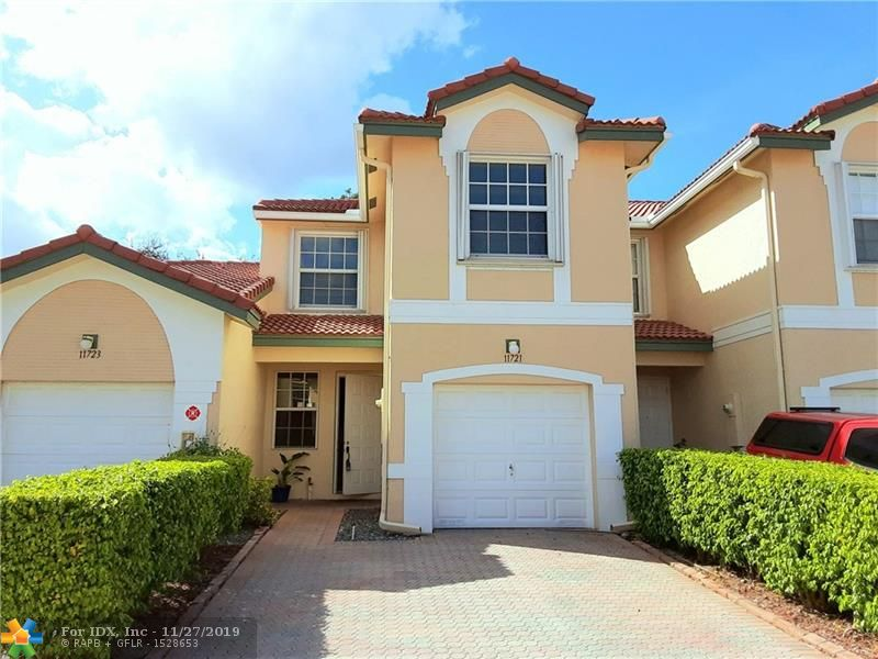 """One of the best locations in Coral Springs, beautiful 3 beds 2.5 baths townhome with garage in the prestigious """"Wyndham Lakes"""" community, in the gated and private subdivision of Pelican Pointe. Low Hoa fee of $239, maintenance of the roof is included. This home features an Upgraded kitchen, brand new stainless steel appliances, new kitchen cabinets doors, Modern Full backsplash quartz countertops, under-mount new Sink and wood laminate floors on the upper level, ceramic on the lower level, no carpet anywhere. A/C installed in 2017, both upper-level baths have dual sinks, master bed has a walk-in closet, washer, and dryer on the upper level, screened patio, accordion hurricane shutters on top-level and panel shutters on lower level.A+schools. The property is freshly painted!"""