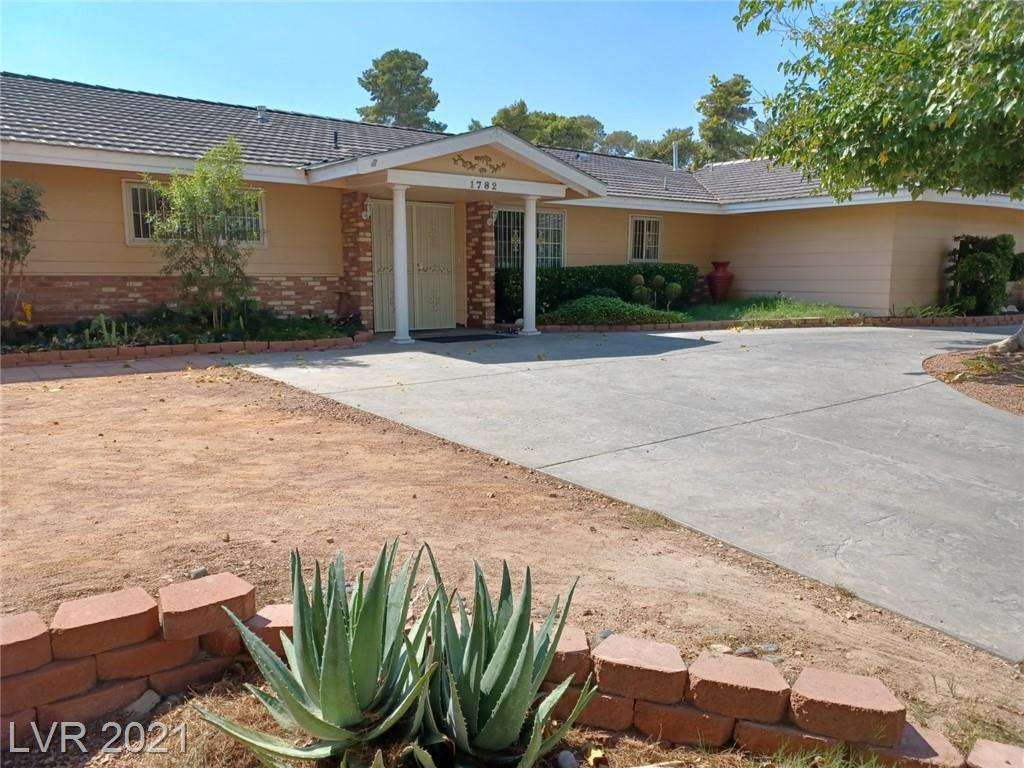 This beautiful 5 bedrooms, 3.5 bathroom single story sparling ranch located on a half acre corner lot features RV parking and a casita with private entry. Additional features include: circular driveway, covered carport, covered patio, side courtyard, and an extra spacious landscaped backyard. Sparkling pool and spa with diving board and privacy gate. Centrally located to shopping and dining on the strip