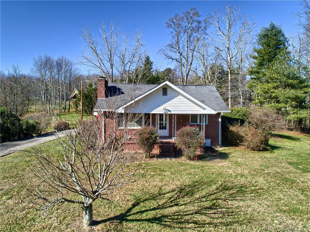 Come see this nice 2/1 brick home on 2.27 acres, with a country feel but still only a short drive to town!  Beautiful country setting, with a stream and huge yard!  The main house is 2/1 with covered front porch for relaxing and the detached garage has an efficiency apartment plus parking.  Tons of room and potential here to occupy one house and rent the other. Septic is shared between house and garage apartment.