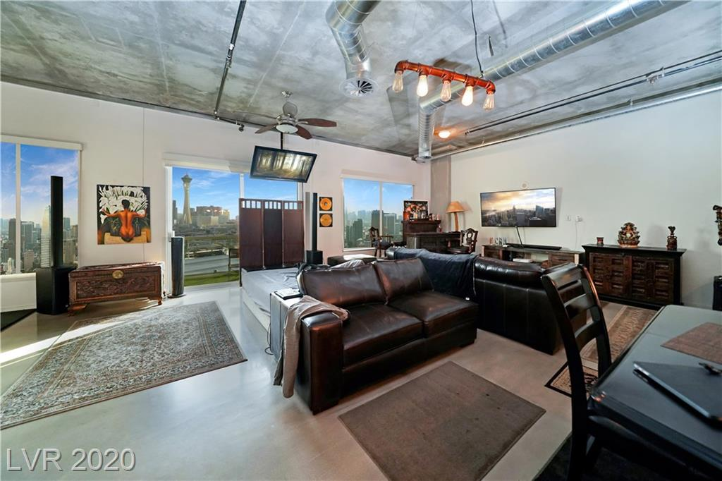 A rare find! True loft living in the heart of the 18b Art's District in DTLV. Enjoy the most coveted Strip views from this 12th floor residence. The unit features has a walk through custom closet, spa like bath with jetted tub and walk in shower. Polished concrete floors throughout. The kitchen is a chef's dream with an over sized island and gas range. In All this in a full service building with roof top pool, gym and more.