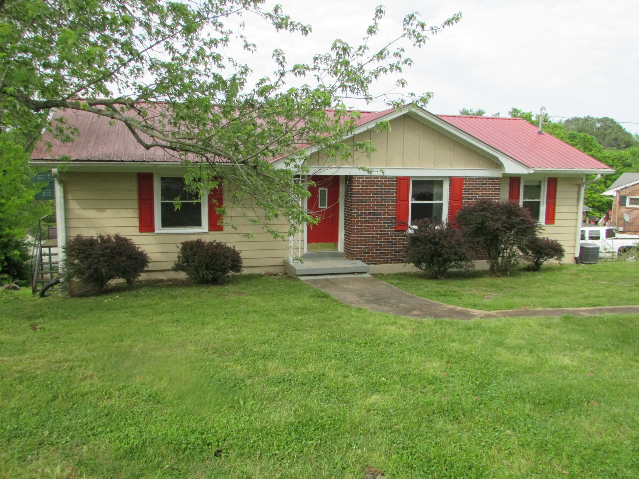 ABSOLUTE AUCTION! Saturday May 30th at 10:00 a.m.  3 Bedroom home with living room, eat in kitchen, dining room and bath.  Full basement with one car garage and bath. Recently improved with refinished hardwood floors, paint, metal roof, and replacement windows. Good deep lot.