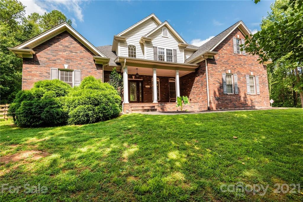"""This all brick, 1 1/2 story home sits on a very private lot located in Hawks Ridge on over 1.5 acres.  This beautifully maintained home has 4 bedrooms, 3 full baths and a bonus room.  The extra deep """"rocking chair"""" front porch welcomes you into the foyer where you notice many features including archways, columns & wood floors throughout.  The family room has a vaulted ceiling, gas logs, & lots of natural light. The kitchen is open and overlooks the family room, featuring an """"eat-at"""" kitchen island, granite countertops, pantry & laundry room close by.  The master bedroom is located on the main level w/ master bath featuring double vanity sinks, separate tub & shower, walk-in closet, & private toilet.  A 2nd bedroom is located on the main level with a full bathroom beside it.  The upper level has bedrooms 2, 3, a 3rd full bathroom & bonus room w/ a balcony overlooking the family room.  The back yard is fenced w/ a large back deck & small outbuilding w/ electricity in the back of the lot."""