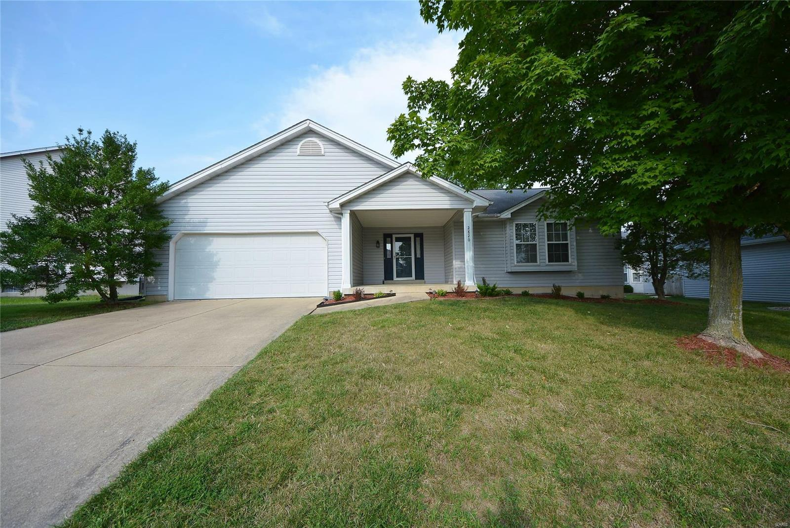 WELCOME HOME to this 3BR 2BTH great rm ranch w/1750+SF in the heart of O'Fallon. The exterior of this home has beautiful curb appeal w/vinyl front, lush landscaping & 2 car garage. Walking in you'll notice the open floor plan w/the spacious great rm offing tall vaulted ceilings & featuring a WB fireplace flanked by windows & opens to the kitchen w/Corian countertops, bkft bar, stylish black appliances, pantry, bkft rm & vaulted sun rm w/slider to the deck overlooking the lvl yard perfect for outdoor enjoyment. The MF master suite provides a walk in closet & private full bth. 2add'l BR, full BTH & laundry complete the main. Other features included newer HVAC, fresh paint & Great location w/easy access to major hwys, great schools, shopping & restaurants. This is a well cared for, solid home that is move in ready! A MUST SEE!
