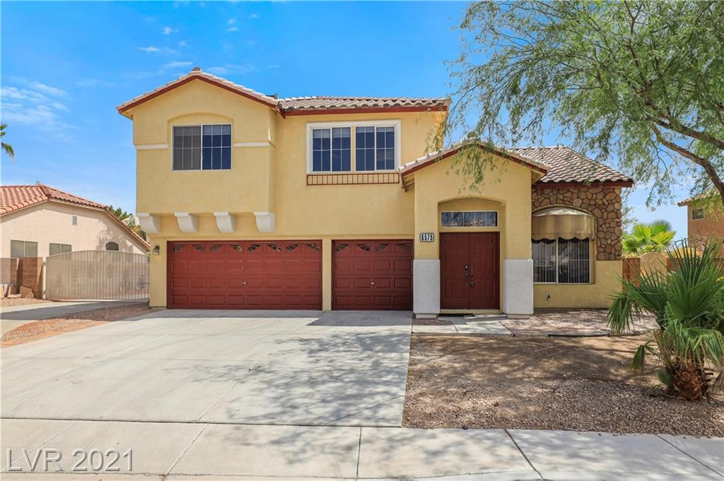 Strip, Mtn & City views plus RV Parking & no HOA! Terrific 2-story w/4BDRs, 2 3/4BTHs, loft & 3-car garage! Home features 1BDR down & BTH down w/shower. Fantastic double door entry into home opening into formal living room elevated w/vaulted ceiling & step up to formal dining room w/lovely pot shelves. Pleasing kitchen has center island w/storage, tile counters, built-in microwave, recessed lighting, window above sink & kitchen nook. Sunken family room is off kitchen & elevated w/hardwood floors, cozy fireplace & French door leading to patio. Primary suite, 2 secondary BDRs & loft are upstairs. Generously sized primary suite boasts a vaulted ceiling, cozy fireplace, ceiling fan, walk-in closet & double French door leading to large private balcony. Ensuite is equipped w/dual sink vanity, solid surface countertop, separate makeup station, soaking tub & walk-in shower. Backyard is finished w/large covered patio, lush grass lawn & beautiful mature landscaping. This is one to see!