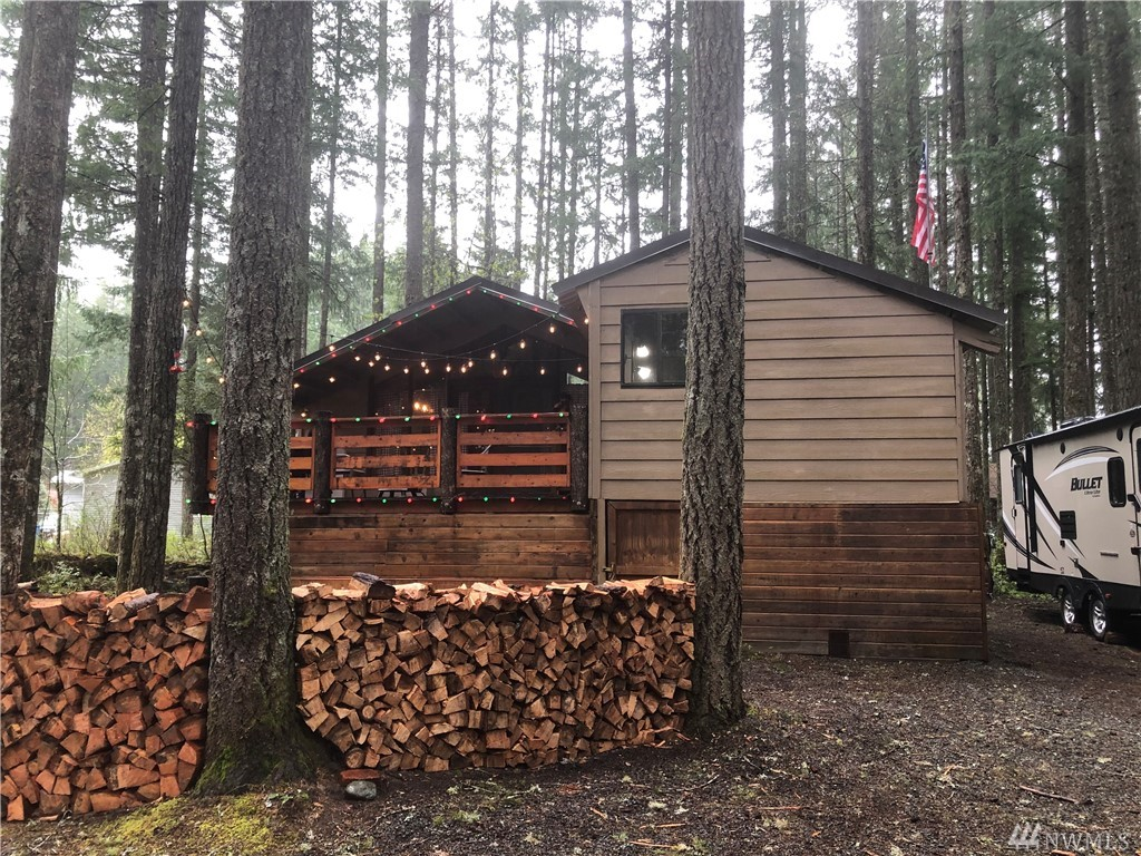 Super cute cabin in High Valley! Built on extended post and pier with plenty of storage underneath.  Main cabin includes living room, kitchen/dining room, bedroom and bath. Additional large bedroom  off deck. Natural low-maintenance forested lot with an adorable gnome trail in back. Metal roof.  Annual $378 dues include water use, golf and summer swimming pools. Close to Mount Rainier Nat'l  Park, White Pass Ski Area, Goat Rocks and Tatoosh Wilderness areas! Keep the Traeger with fullprice offer
