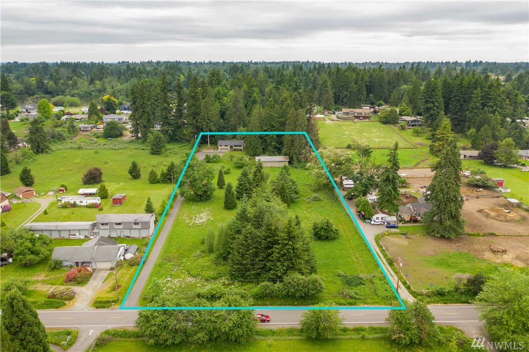 3.7 acres of unlimited potential! This 2,460sf 3 bed/2.5 bath home has a brand new roof, A/C & large lower level great room w/half bath; a  blank canvas ready for your personal touches. The home sits back from the main road which gives the fully fenced property a very private feel. There's also a separate 30'x60' shop already equipped w/ power (+ another shed) – use it as a garage, barn, whatever you need. Country living while being close to city amenities – doesn't get much better than that!