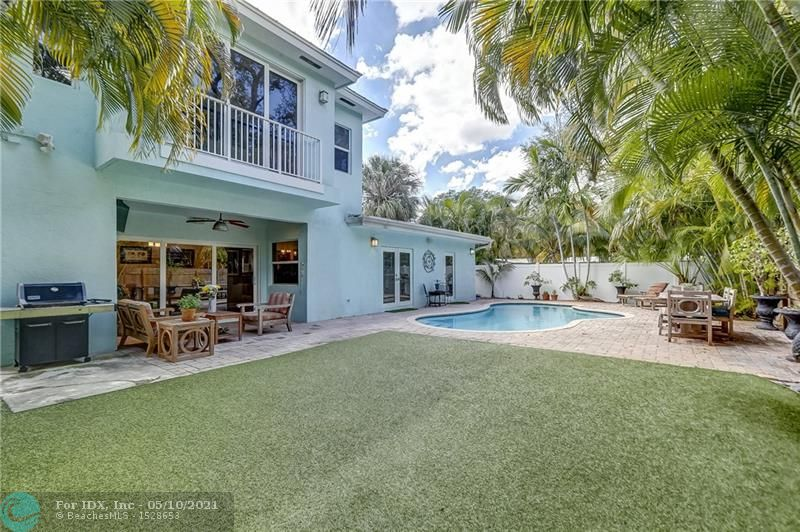 Truly rare find in Middle River Terrace. MRT perfectly situated to be walking distance to Wilton Drive & the new 13th St lifestyle corridor, 2.5 miles from beach, 3 miles to Las Olas & 15 min drive to FLL airport.  Over 2300 sqft- 1/3 built new in 2013 w/addition of first floor game room & second floor master suite featuring large walk in closet, Carrera marble bath w/ separate glass encl shower & slipper tub. 50 year metal roof 2013, 3 zone ac, impact windows & doors. Warm wood floors through entire first story. Updated throughout & meticulously maintained. Kitchen features GAS Viking stove, Bosch dw, granite counters & opens to allow for endless hours of gathering & entertaining. Large corner lot w/ salt chlor pool, pavers, & maintenance free turf allows for privacy & enjoyment.