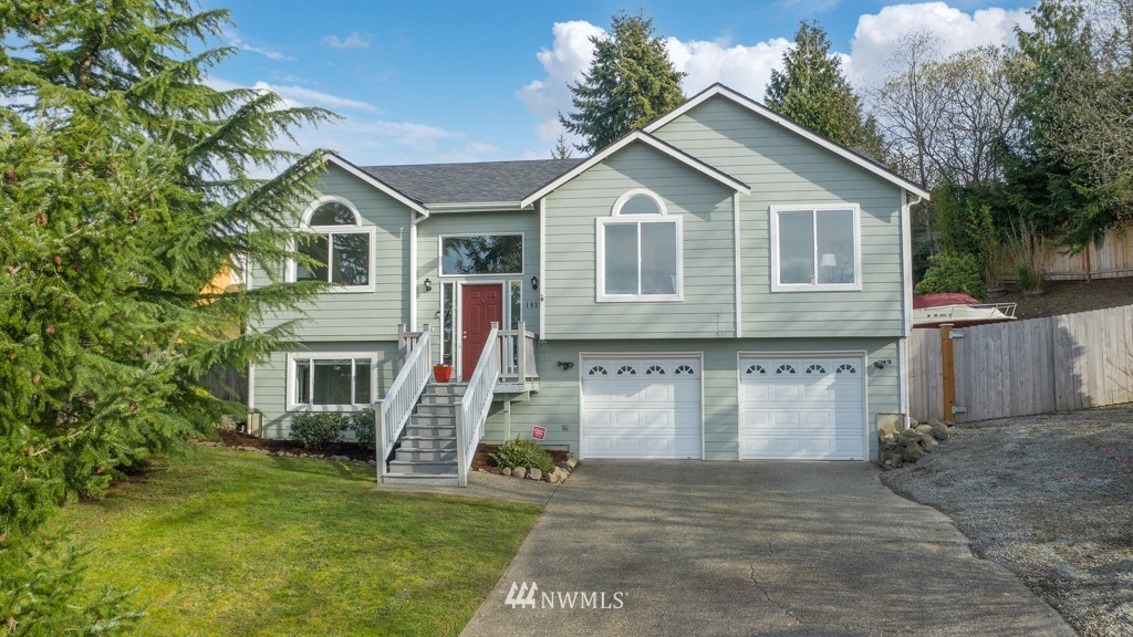This move in ready home boasts abundant natural light and the perfect floorplan! The spacious living room with fireplace opens to the breakfast nook and kitchen. Enjoy dinners in the formal dining area and entertain friends and BBQ on the huge wrap around deck. Main level also features a beautiful owner's suite with walk-in closet and bathroom with double sinks and skylight, plus 2 more bedrooms & a full bath. Downstairs opens to large rec room, full bathroom and 4th bedroom. Fresh paint throughout, new carpet, new fence, and new furnace & AC installed in 2019. Don't miss the oversized 2 car garage and extra parking. Plenty of room in the back yard for games and s'mores! Just minutes to Saltwater State Park, shops & restaurants!