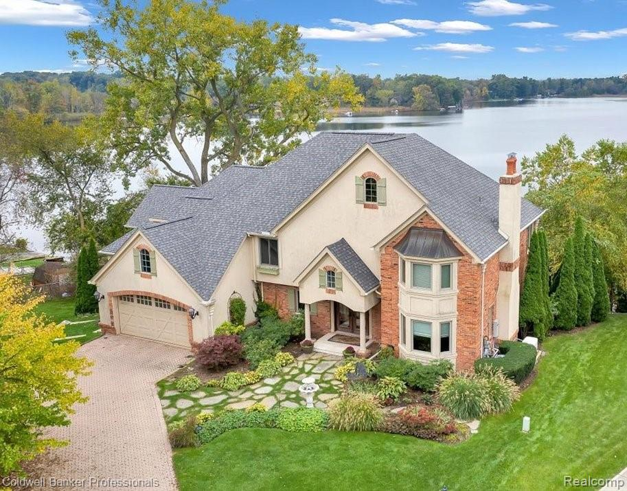 Spectacular ALL SPORTS LAKEFRONT home. This truly exquisite 4 bedroom(with option for 5th bedroom in lower level) home features gorgeous curb appeal on a cul de sac,  breathtaking views of the highly desirable all sports Lake Voorheis with over 100ft of frontage and completely custom finishes throughout.  Updates include new 3 dimensional roof 2021, new windows 2020, new furnace 2021, completely retiled infinity edge pool, all new gutters 2020, whole house generator, heated floors in the master bath, completely remodeled wine cellar and more.  With over 5000 square feet of main living space as well as a fabulous Florida room and a gorgeous 2700 square ft lower level walkout, featuring 5 fireplaces, this home will allow for all the family and entertaining space you need.  Excluded are the washer & dryer and refrigerator in workout room.  Buyer/buyer agent to verify all information.  Preapproval required prior to viewing home.