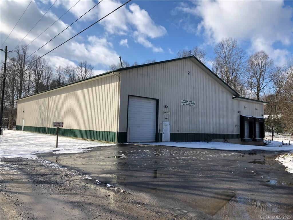 2 commercial buildings on 2.87 level acres, open use zoning, behind KD's convenient store & GULF gas station, health food market/deli that border Scenic Highway 74A in the heart of Fairview.  Seller will consider some owner financing.  One building is 7600+ square feet Morton Building with three loading docks, workers restroom and office, concrete floors, insulated walls and ceiling.  Second building is 4600+ square feet wooden structure with loading dock, front porch, restrooms, offices, warehouse,  etc. Price negotiable. Make offer!