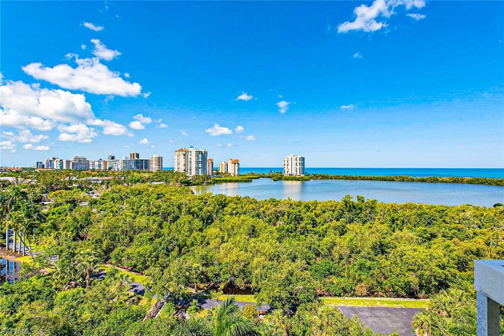 Extraordinary views and tremendous value can be found in this casual 8th-floor residence featuring mesmerizing views of Clam Pass, the Gulf of Mexico and distant Park Shore city lights. This split 2 bedroom with den floor plan can be converted to a 3rd bedroom or used as flex space as needed. St. Tropez recently remodeled their common areas in a coastal contemporary flair and the building is being painted this summer in a cool gray tone this summer as expressed in the photo. Contact your agent today to schedule an appointment or check out the Matterport virtual tour for more information!