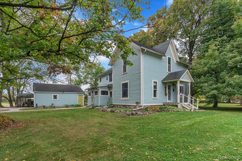 **ALL HIGHEST & BEST OFFERS DUE BY MONDAY 10/18/21 @ 12 noon**. If you are looking for a home that is not in a subdivision, and need room for toys, then come take a look at this charming farmhouse on 2 lots totaling 1.13 Acres with room for another outbuilding or pole barn. Located in Mundy Twp, Grand Blanc mailing and Linden School district. It is a great location in proximity to US-23, I-75, Genesys, Fenton, Linden, and Grand Blanc, yet just far enough away to feel like rural living. Fresh paint throughout the interior, shiny hardwood floors, and beautiful details characteristic of a home built in 1900 are maintained while mixed with some more recent updates to the kitchen, bathrooms and fixtures and a new roof.  The master bedroom has a gas fireplace and walk in closet.  A covered porch and shaded fieldstone patio overlook the large yard with mature trees. There is even a chicken coop, a fire pit, and a tree swing in the side yard!