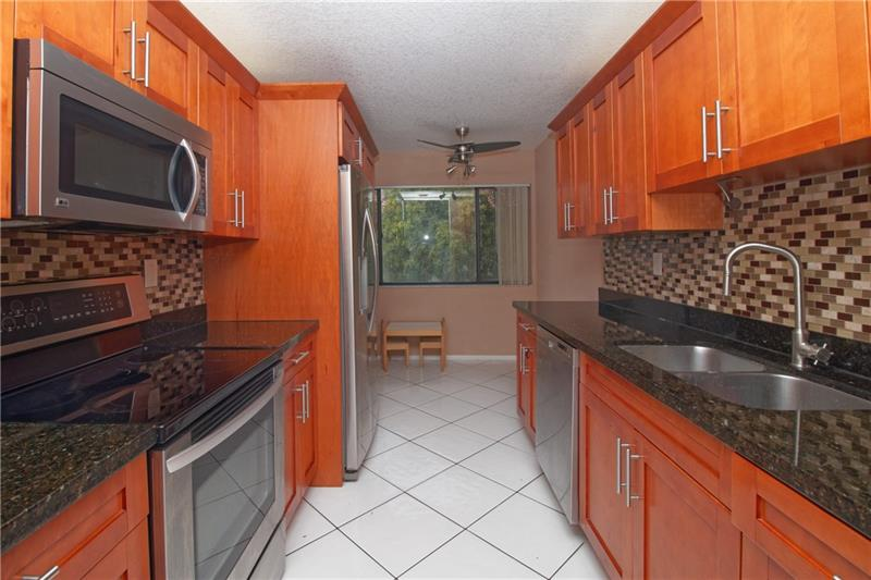 Large corner unit. Located at River Edge Coral springs,Fl, 3 bedroom 2 bath condo with beautiful water views. Tile throughout, updated kitchen and SS appliances. Rarely available. Can Rent right away and pet friendly. Washer and dryer in unit. Travella school district. Centralized location. Make your appointment today! This area is surrounded by parks, dogs parks  and right next door to boat ramp on C-14 Canal.