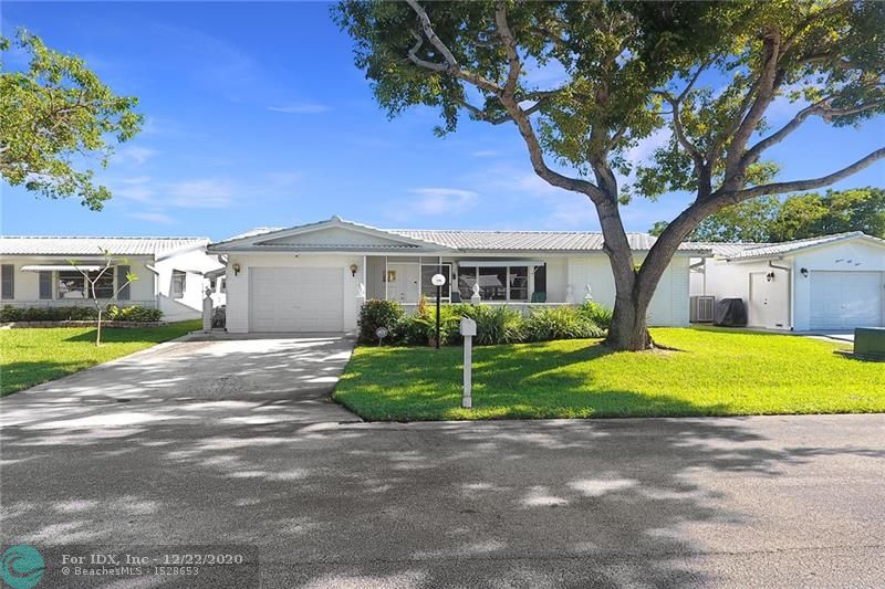"""Location, Location, with this extended Lakeview Model on wide waterway with east exposure in rear for the best breeze...Split bedroom plan with two masters, one being used as an office, living room, dining room, family room, large florida room and additional screened patio..storm and hurricane protection to include sunsetter window covering in rear, double wide driveway, additional front screened patio, new overhead garage door with opener, hurricane proof, new refrigerator, washer and dryer...roof, four years new...over """"55"""" active community, hopa verified, lots of amenities to include courtesy bus and active clubhouse...complete exterior care by assn, to include roof, lawn exterior paint and basic cable..see attachments for application..more photos to come"""