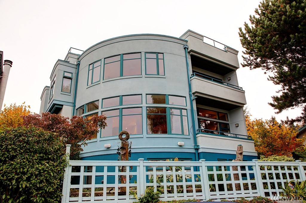 First time on the market. An amazing property. Enjoy HUGE views from all 3 floors & from the ROOFTOP DECK. From downtown Bellevue to Mt Rainier, this Lake Washington home has THE BEST views. Private and secure location on a street-to-street lot right in the heart of Leschi. Original structure completely rebuilt in 1996 to exacting standards. Quality construction, high-end finishes, & lots of room define this home. Ideal master suite plus 2 more beds up. Large guest suite on lower level. Bliss!