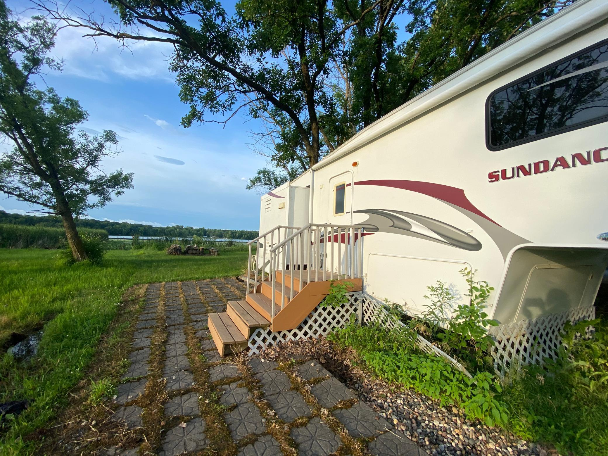 Excellent opportunity to own affordable lake place with no association. Lot located just one hour from the metro. Included in sale: well, septic, dock, and 5th wheel travel trailer.
