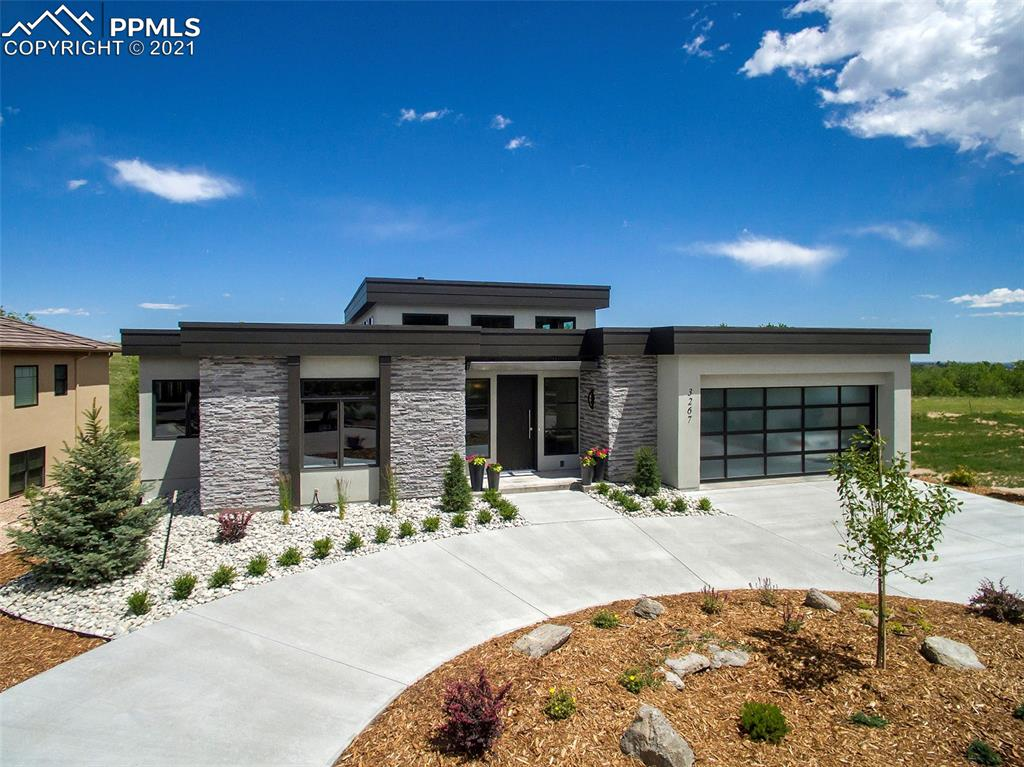 This gorgeous new construction home was just completed in 2019.  The soft contemporary design features 4 bedrooms, study, 4 baths, 2-car garage plus room for golf cart, an open floor plan, sleek clean lines throughout with neutral colors, amazing hickory flooring, 15 foot ceilings and the option for one level living.  The main level includes the great room with fireplace, adjoining dining room, gourmet kitchen, two bedrooms and study with maple cabinetry. The main level also features a wonderful private deck with fireplace and cabled railings. The kitchen offers all the luxuries with quartz countertops, high-end appliances, large island and pantry.  The two main level bedrooms include the spacious master suite with 5-piece bath, walk-in closet and second laundry. The lower level features two bedrooms, bath and 826 sq. ft. unfinished space offering room to expand.