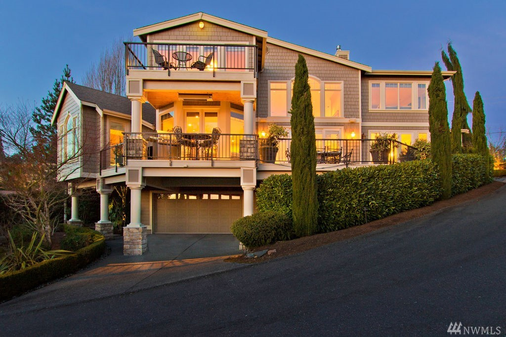 Touch of Tuscan Flare in The Highlands. Entry by a waterfall enhanced porte-cochere through glass doors to enjoy views of the City, Lake & Olympics. Great Room plan w/high soaring ceilings, gourmet kitchen & large dining. Main Master suite includes heated jetted tub, glass block shower & heated floors. Media/Home Theater w/projector & big screen all stay! Lower has entertaining Rec Room, wine cellar, bed, bath & pre-plumbed for possible kitchen. Expansive entertaining deck w/barbecue & heater.