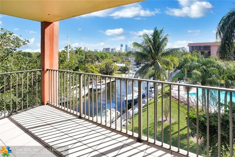 Welcome to the gated, private island community of River Reach just minutes from downtown Ft. Lauderdale. This well appointed 1500 sq feet Astor model features split bedrooms and neutral tile throughout. Remodeled pass-thru kitchen with custom cabinets plus extended pantry, stainless appliances, granite counters, and recessed lighting. East facing corner unit with oversized balcony overlooking deep water, ocean access canal and pool. Enjoy morning sunrises or evening views of Lauderdale's growing skyline. Renovated bathrooms and custom walk-in closets. Garage parking plus additional storage. Amenities include tennis, 3 community heated pools, club room, gym, kayaking/paddle boarding, 24 hr gated security plus guard. Pet friendly (2 pets under 20 lbs). DOCKAGE UP TO 50' when available.