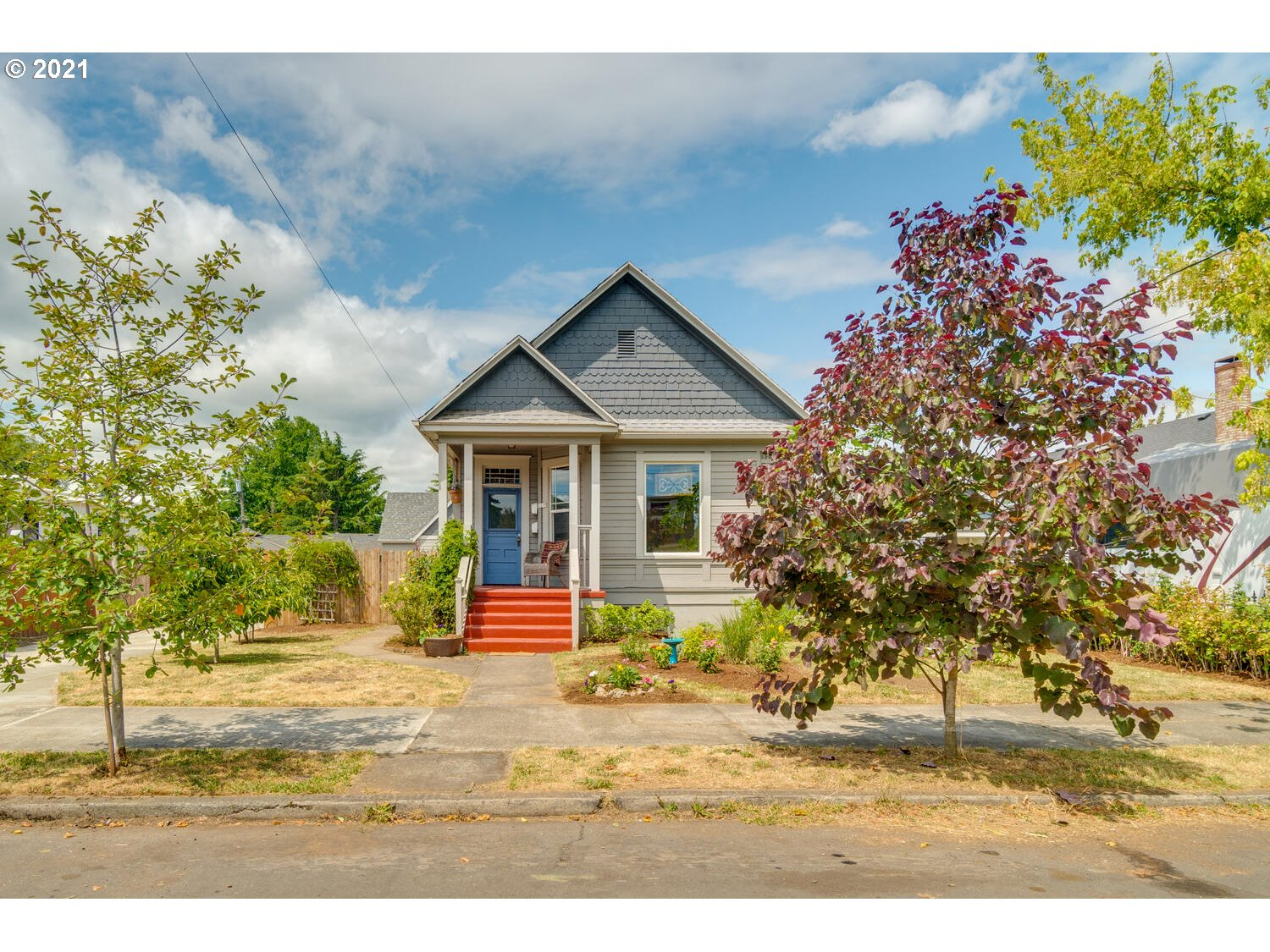 """Colorful 1904 Victorian with high ceilings, hardwood floors, remodeled quartz counter kitchen and ADU above 2 car garage! ADU currently rented at $1,525, (possession subject to current tenancy) was built for AirBnb in mind. Main house has 2 beds on main floor and 2 beds/baths down, 4 total full baths! (inc. ADU). Original vintage mill work, hardware and 48"""" pocket door! Nestled just 4-5 blocks from hot St. John's! Perfect for dual living and more. FA gas heat and on-demand water heaters."""
