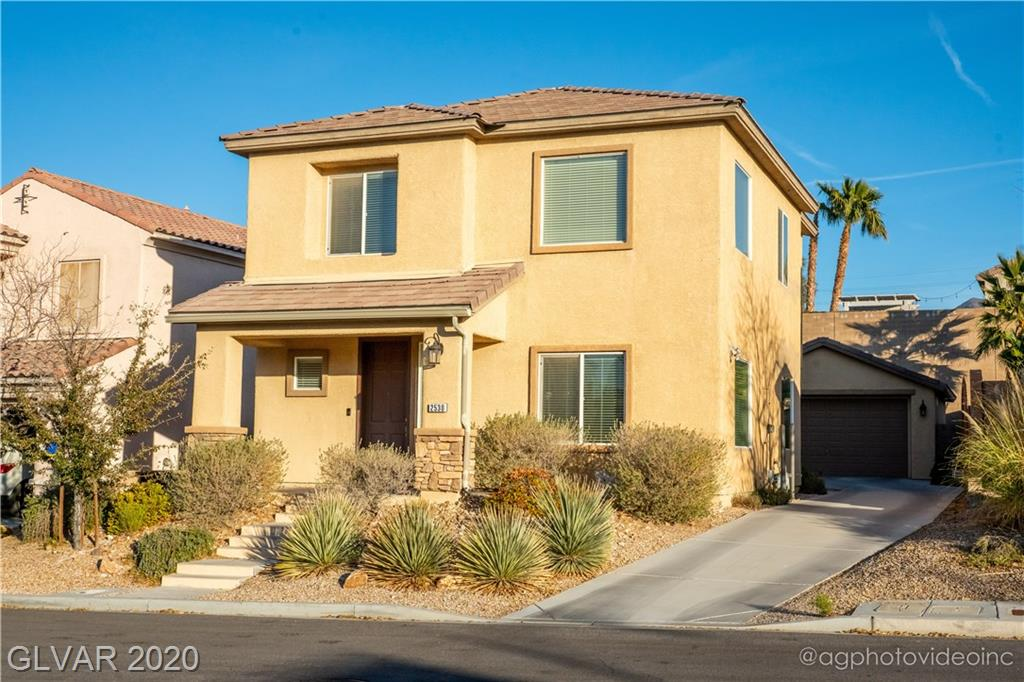 Beautiful home in the Highly Desirable Anthem Highlands-Gorgeous island kitchen with upgraded Hickory cabinetry, granite countertops, stainless steel appliances, built-in oven & eat in area-Living room with cathedral ceiling-Large family room w/ media niche-18x18 tile diagonally set all of downstairs-Dining room with niche for china cabinet-Surround sound pre-wired-Top rated schools-Near beautiful parks-And so much more. A true MUST SEE!