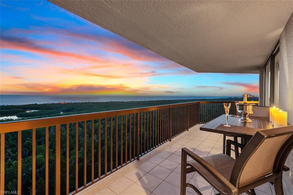 Dramatic Gulf views surround this coveted, rarely available 14th floor Dorchester residence with an oversized balcony that wraps around showcasing stunning frontal views of Clam Pass and up the coast as far as the eye can see. Recently renovated in a soft transitional style with clean lines, the layout has been reimagined to provide an unobstructed corner Gulf view through walls of glass. The sweeping view extends to master and guest suites, each with access to the expansive balcony. The open kitchen is luxuriously finished with new custom cabinets, Taj Mahal counters and high-end appliances. Additional features include a raised ceiling and great room floor, new widened impact glass sliders, fine wood flooring, new bathroom cabinets, Crema Marfil marble and Jacuzzi tub in master and more. Dorchester is ideally located with a beach tram pickup stop just outside the rear door. Building amenities include renovated common areas, fitness center, two guest suites, pool, spa and grill area, on-site management, and parking garage with separate lobby. Residents also enjoy the unrivaled benefits of the Pelican Bay community including private beach access, beach clubs, restaurants and tennis.