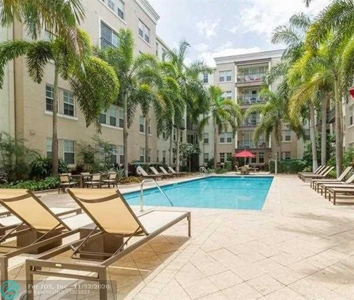 "RARE one bedroom condo with balcony overlooking the peaceful zen garden with its beautiful fountain at ""Sole"" in hip Flagler Village, the new downtown Ft Lauderdale! This move-in ready condo offers beautiful hardwood floors & stainless steel appliance & a large walk in closet! The HOA fee covers not only water, trash, amenities etc. but also cable & internet! Full amenities' building incl. pool, hot tub, BBQ, zen garden, fitness center, clubhouse, business center, roof top deck with 360 degree views of downtown! 