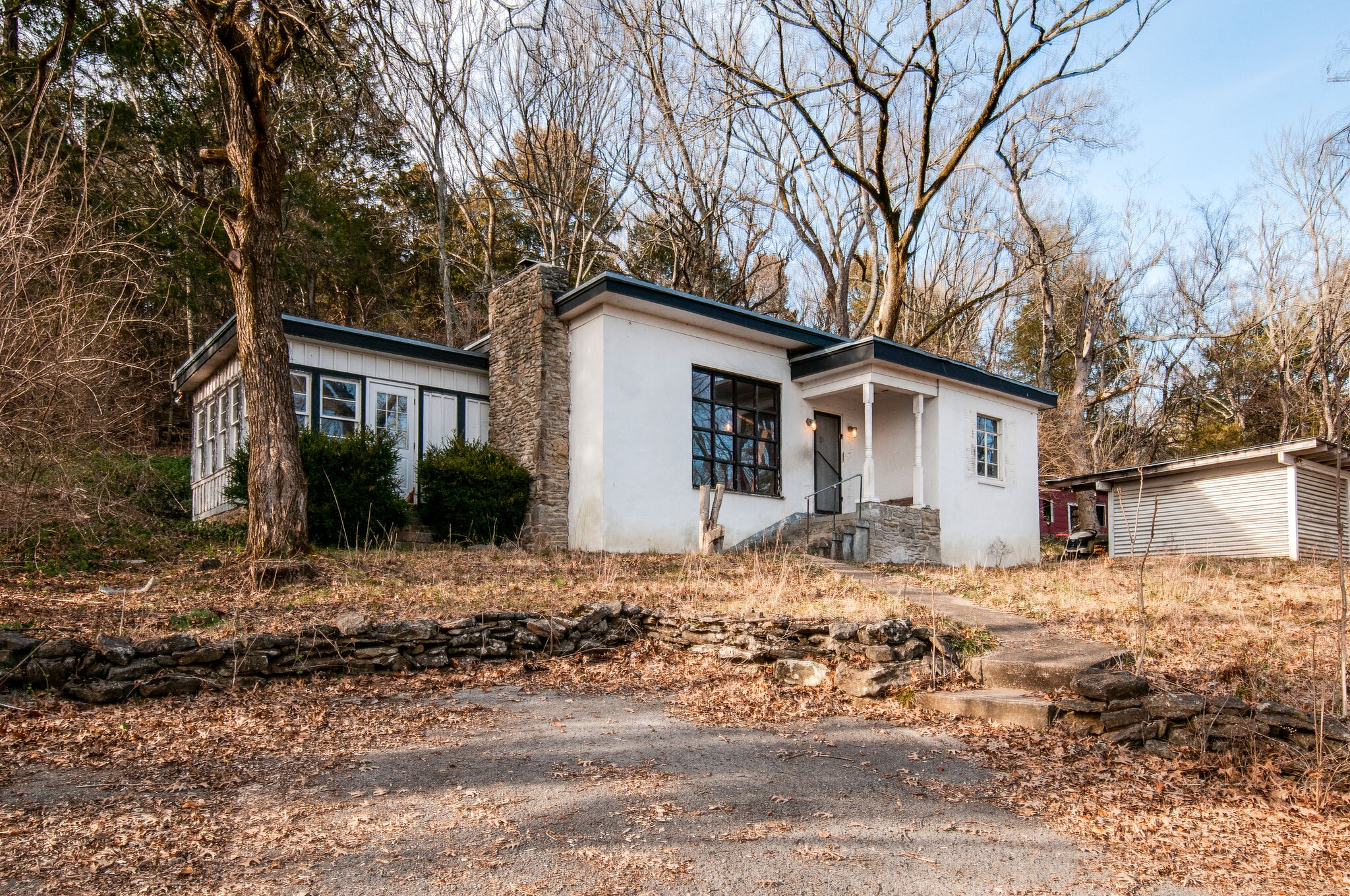 Amazing Private property on 1.4 wooded acres right across from Legends Golf Club ! * NEEDS TLC -Selling AS-IS - Offers due by 1/30 @ 6:30pm w/ deadline to respond by Sun @ noon. Perfect for building site, renovating and/or affordable living in Williamson County