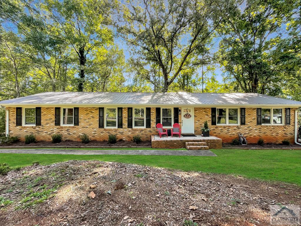 Come view this home for the first viewing at the OPEN HOUSE this Sunday, October 10th from 1-3pm!  This 3,094 SF ranch home over a finished basement offers so much finished space as well as a HUGE deck for your family and friends to gather.  Step in the front door to an open floor plan with beautiful laminate hardwood floors in the Great Room with a fireplace, breakfast area, Dining Room and Kitchen all open to one another.  This allows for conversations and viewing each other while using the living spaces.  The Kitchen has granite counter tops, custom cabinets, stainless appliances, and tile flooring.  The Utility Room has cabinets which is located off the Kitchen and a separate oversized storage/pantry is beyond the utility room.  There is a second level deck to enjoy off the Kitchen.  There are three bedrooms with carpet and two full bathrooms on the main level.  The guest full bathroom has granite counters with a double vanity including tile flooring.  The Master Bedroom has two closets and the Master Bathroom has a tiled shower with glass door and tiled floor.  In the finished basement is a Kitchenette with a sink, one full large bathroom, one HUGE bedroom with a LARGE walk-in closet, Man Cave Area or Could be Craft or Art Area, utility room with storage and a large storage closet.  Step out the back from the basement to a Deck that is AMAZING!  It spans the entire backside of the home and is ready for your friends and family!  It overlooks a fenced backyard with views of the woods and NATURE.  A new metal roof was installed in 2018.  This property sits 2 minutes from the UGA Vet Hospital, 5 minutes from UGA's Lake Herrick with miles of walking trails around the lake and tennis courts, and 8 minutes to UGA and Five Points.  Come Sunday, October 10th from 1-3pm to the Open House!
