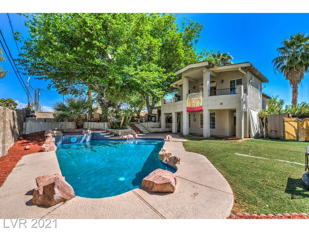 ENTERTAINER'S DREAM HOME with POOL and SPA on the GOLF COURSE with LAKE VIEWS! You MUST SEE this property and feel the GOOD VIBES/ENERGY throughout the space! No HOA's and zoned for both Residential and Commercial! Huge Primary bedroom with en-suite and VIEWS of STRIP HOTELS from the BALCONY! Newer custom white cabinets in the kitchen with quartz counter tops and stainless steel appliances. Multiple entertaining spaces inside and outside! The lot is over 12,000 square feet! DO NOT MISS THIS ONE OF A KIND GEM!