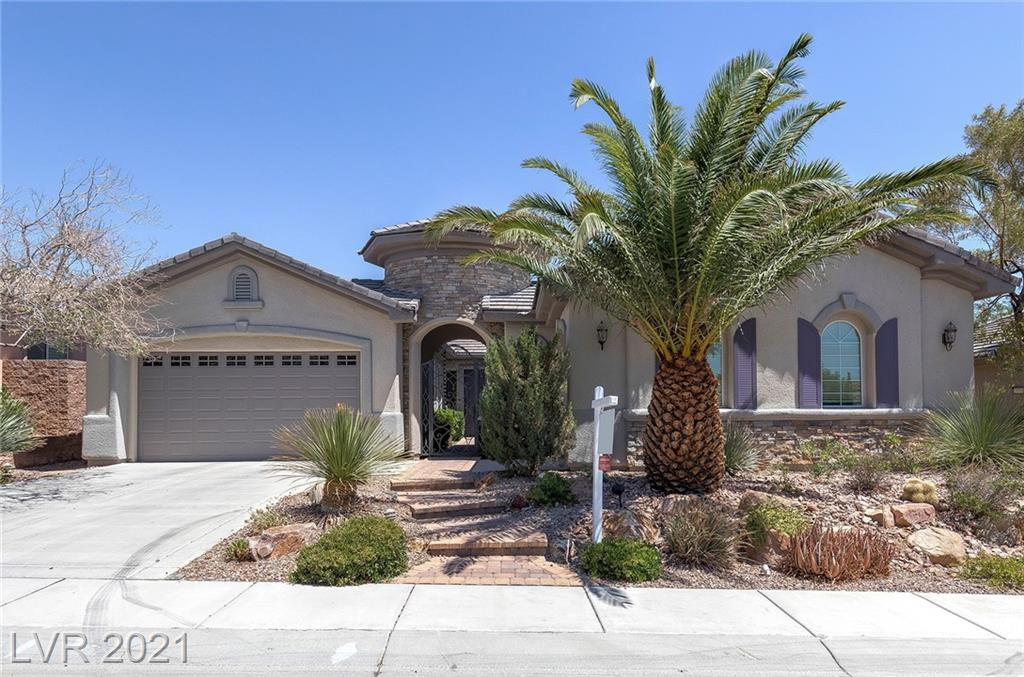 Fantastic floor plan with spacious rooms! Self locking gated courtyard & large under roof covered patio helps to bring the outdoors in! Tumbled travertine flooring throughout all rooms except two bedrooms. Huge kitchen with plenty of cabinet & counter space, breakfast bar & nook. The great room is nice & very large at 23X23 feet! Full wall windows provides a wonderful view of the backyard plus have remote control shades! The primary bedroom & bathroom provide a very comfortable suite including a fireplace, huge oval tub, walk in shower with bench, dual sinks, & a custom closet organizer. The home office is a great space for working from home or could be a 4th bedroom if needed. Recent updates include garage door and both openers (2 years old), new York hi efficiency HVAC and A/C units valued at $26,000 & a new water heater! Great location for this wonderful home near Red Rock Canyon, the Red Rock Resort, Downtown Summerlin, restaurants, Costco, Golden Knight HQ & Aviators Ballpark!