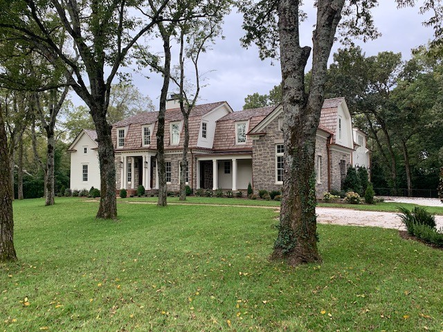 1.3 acres in Belle Meade.  Walk to Belle Meade country club.  Canadian Cedar roof. Copper gutters.  Brazilian quartzite and Italian marble. European cut wide plank white oak floors. Tankless water heater. Wood burning fireplaces. Stone terrace with covered porch. Please use TAR Purchase and Sale Agreement. (Current addition if possible please)