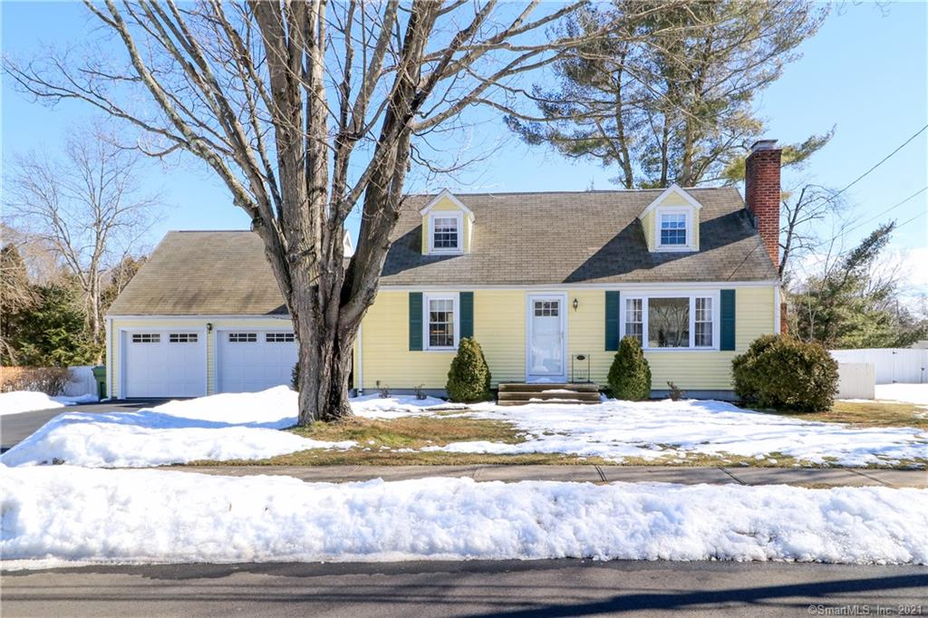 A most desirable Riverfield School neighborhood is the setting for this Classic New England Cape Cod sited on over 1/4 acre of level lawns. Entering the front door you are introduced into a sunny formal Living Room featuring a warming fireplace and built in bookshelves. A gleaming white Kitchen with stainless appliances and quartz countertops is open to the Dining Room with built in china closet. Adjacent to the open Kitchen/Dining Room is a convenient Mudroom and the spacious Family Room. The Family Room with vaulted ceiling & wood stove offers access to a 3 season Sunroom and expansive private Deck. A first floor Master or Guest Bedroom with ceiling fan, 2 generous second floor Bedrooms with ceiling fans and 2 full Baths provide for family or friends.  Accessed from the Kitchen and a stairway from the Family Room always useful and much appreciated recreation/play/office space is found on the lower level. Need even more space? a large storage room (possible future expansion?) resides over the 2 car Garage. Conveniently located approximately 2 miles to Fairfield Center and Train on a quiet street this charming home has it all...