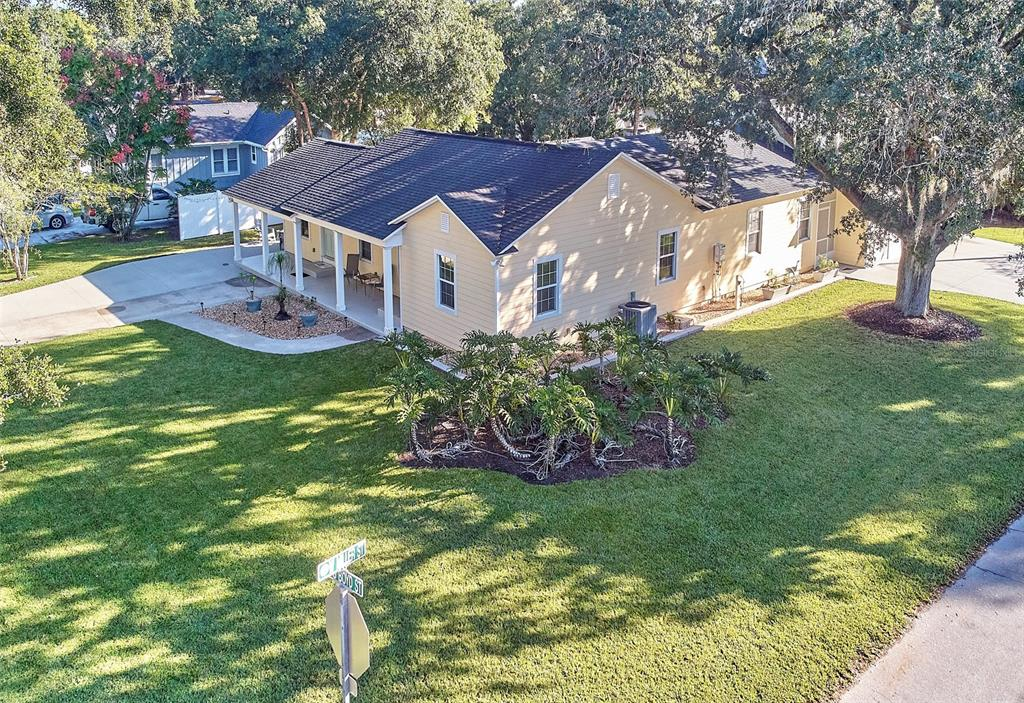 **RARE OPPORTUNITY  In the HEART of  DOWNTOWN WINTER GARDEN~ Mainly Taken Down to the studs & Rebuilt! ** This Modern Farmhouse style home complete with INLAW SUITE for multigenerational living- or rental income- is steps to downtown WG, IN the Golf Cart District on over 1/3 acre, corner lot with NO HOA!   Want the CHARM and Character with Everything Already REDONE?? To include Roof, 4.5 Ton AC with dehumidifier, Electrical (New Panels, wiring, outlets) , Plumbing (Drain & Supply lines) , Plantation Shutters throughout the Main home *Original Wood Floors refinished, New Ceramic in wet areas, Paint In & Out,  Tankless Gas Water Heater * Remodeled Kitchen & Bathrooms * Sparking Quartz countertops* Transferable Termite Bond*~ HUGE-900 SQ FT! MAN'S DREAM GARAGE, Oversized (foam insulation in the attic storage area and under the house too) with it's own Golf Cart Garage Bay HAS BEEN ADDED to the home. Roll up Double Garage Door Front (Miller Street side )and Rear of Garage (screened area beyond back garage door can have sections taken out for drive through).   *Entering the Front Right Side Door for the Main Home, you step into the Open Plan LIVING AREA with refinished original hardwood floors and Plantation Shutters, to the right is a PRIVATE WING with 2 BEDROOMS and completely Redone HALL BATH.  Straight ahead, the Living room opens to the DINING AREA, the sliding barn door to the left offers a new LAUNDRY ROOM and PANTRY.  Beyond the Dining area is the HUGE REMODELED KITCHEN with Bright White Tongue and Groove ceiling, appointed with Sparkling Quartz Counters, Built in Microwave and Cooktop with Stainless Steel Exhaust hood, Stainless Farmhouse sink &  French Door Refrigerator with freezer drawers below.  The Generously sized Island has a Feature piece Quartz Top & In wall Oven, plenty of room for homework, games or guests to visit while you cook.  The kitchen has extra space for a coffee station or Wine bar area and seating.  Off of the kitchen is the Split bedroom p