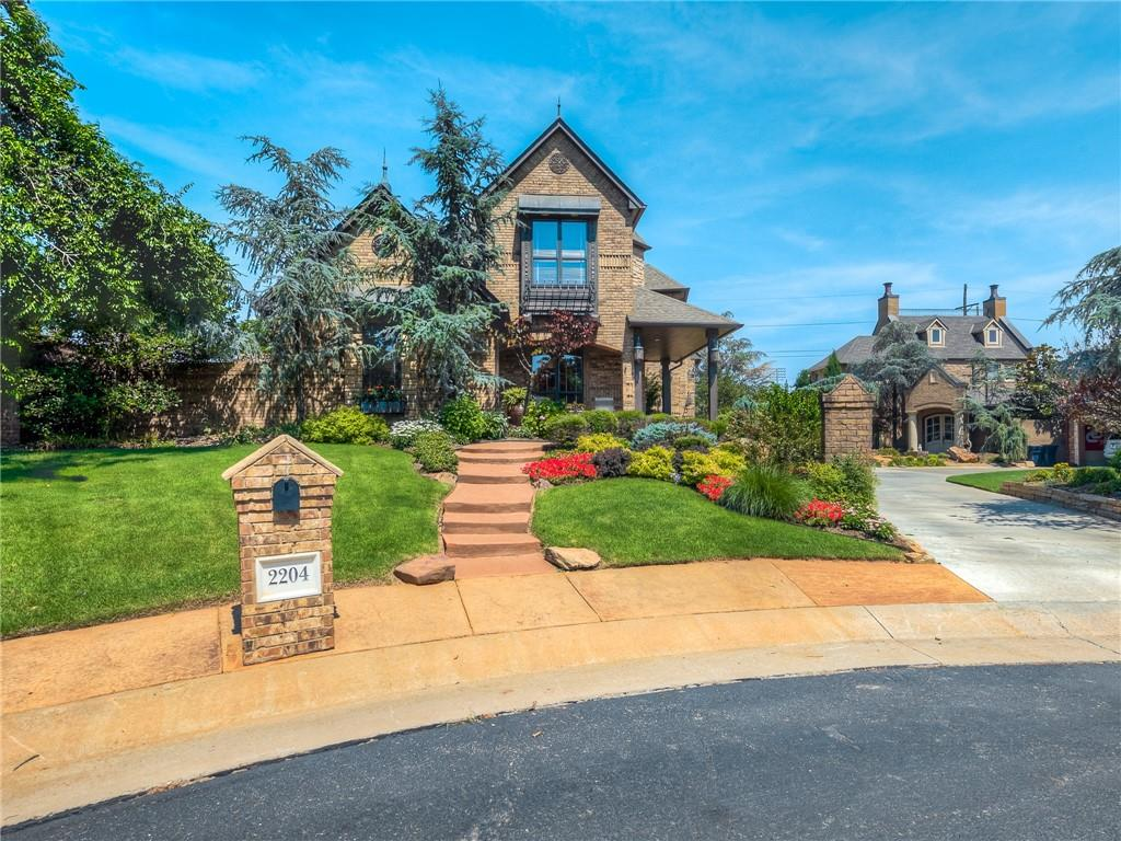 JUST WOW! This home with a view of lake Overholser will truly take your breathe away! You will instantly notice the amazing architecture and curb appeal. Upon entry, you are greeted by wonderfully high ceilings, crown molding, wrought Iron details, glass tiled art cove, and wood floors. The office to your left has a beautiful built in desk, the lovely woodwork on the staircase leads the way into the GRAND family room with its stone fireplace, exposed wooden beams and open floor plan to your DREAM KITCHEN! You will love the large center island with Copper sink and butcher block, 5 burner gas stove, double oven, copper fashioned hood vent and a coffee bar! The AMAZING MASTER RETREAT is on the first floor while the 2 large secondary rooms are upstairs with a full bath. The Master has a lovely claw foot tub, bidet, and true vanity. The outdoor living is AMAZING! 6FT POOL with fountains, large brick wall for privacy. The garage is oversized with a drive-through door into the back yard.