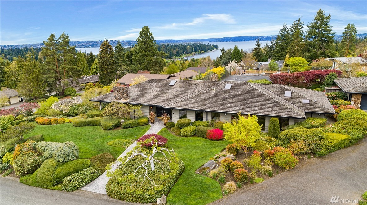 Magnificent views from this ½ acre+ perched on a knoll in the heart of Clyde Hill. 4,290SF 1 owner home is mostly original w/ generous rooms & detached 3 car garage. Sun-filled 200°+ lake, mountain, sunset & city vistas. Arboretum-like grounds w/mature plantings, large patios & privacy. Quiet culdesac just mins from SR-520, dwntwn Bellevue & equidistant to Microsoft & Amazon. Top rated Bellevue schools. Renovate this classic home or build your own estate - this property will fulfill your dreams!