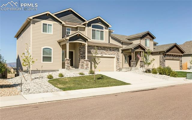 Spectacular Saint Aubyns semi-custom 2-story. Incredible Pikes Peak views with spacious walkout lower level. No expense spared. Granite countertops, stainless steel kitchen package. Soaring ceilings, light & bright. Hurry