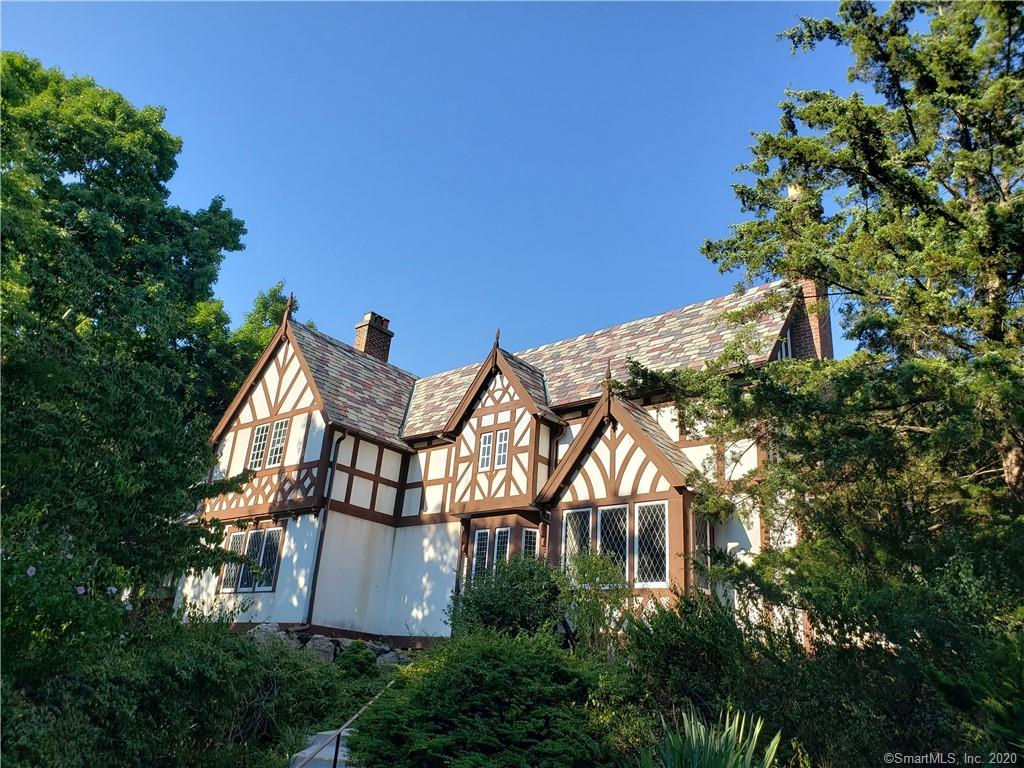 1920's Tudor being sold as is. This 3300 square foot home, while magnificent in its time, is from an era that has passed it by. There is hope that the right buyer is out there with vision and the love of classic architecture to repurpose and restore this home to its original beauty, or a builder who can see this as an opportunity to repaint this canvas.  The home sits on two magnificent, untamed and rugged acres, high above South Compo. A rare opportunity in the heart of Westport to bring new life to this fantastic setting. This site affords exceptional privacy and is dominated by native rock out cropping, shear cliffs, rolling slope and erratic boulders positioned like giant sculptors. Also listed as Land for sale. MLS #170325853 The property was recently vacated by a life use tenant for over 30 years. The owners of the property have never lived in the home and have no first hand knowledge of it condition  of the property as noted in the disclosures. The septic is also unknown and there are no public records.