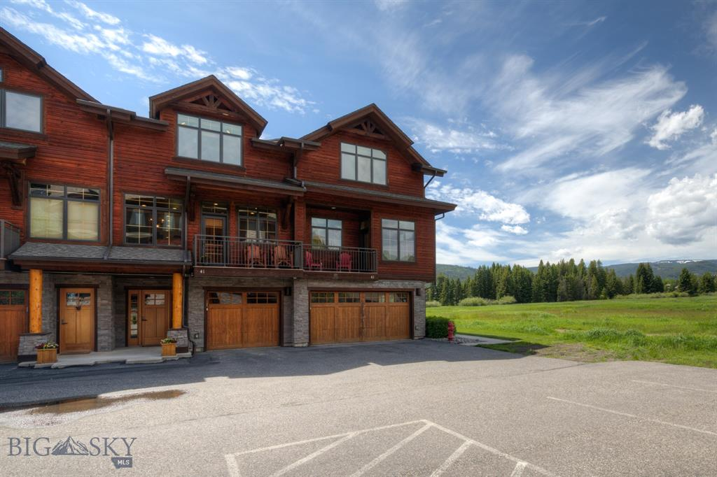 This desirable Spanish Peaks Club Condominium overlooks open space and offers 2 bedrooms + a flex room and 3 baths and a garage all in 2,314sq.ft. of luxurious living space. Amenities include a wood burning rock fireplace, gourmet kitchen, custom finishes and furniture, 2 decks and a patio with a hot tub. This unit is located right on the extensive cross country ski trail system and community trails in the summer months. The clubhouse offers an exercise area, locker rooms, and outdoor pool and hot tub.