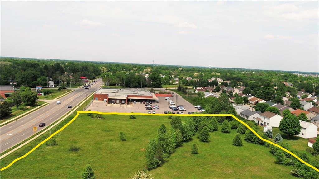 Large Graded Lot with Commercial C-3 Zoning. Excellent Location for Retail, Medical, Restaurant, or Office. No utilities to Site. Approximately 500 Ft. of Pendleton Pike Road Frontage. TIFF Opportunity available on this property through the City of Lawrence.