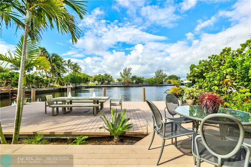 Amazing 300' deep water views & sunsets, tucked in a cove on the Middle River. This home is perfect to entertain & LOADED with upgrades: custom-made Scavolini kitchen, Bosch dishwasher & gas stove, solar panels (2019) powers the entire house ($27,000 upgrade & big savings on electric bill!), whole-house 22 KW generator, impact windows & doors throughout, 5 yr old barrel tile roof, an enormous 800 sq ft dock plus a floating dock in your expansive backyard, salt water pool w/ gas heater, spit floor plan, tankless gas H20heater, natural gas, circular driveway etc. 1 fixed bridge! Located at the end of a cul-de-sac, this home offers real privacy . Totally move-in ready! Bal Harbour is a premier waterfront GATED community east of US-1 close to EVERYTHING. Walk to Wholefoods & Trader Joe's!