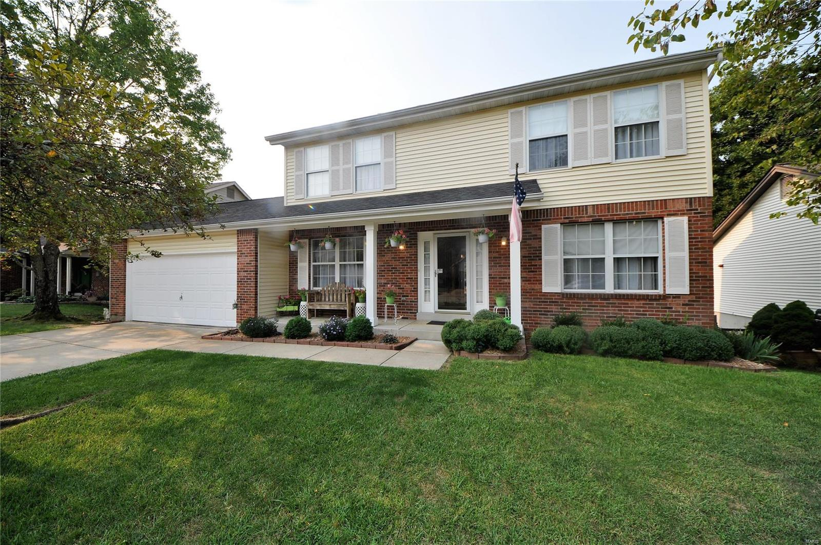 """Updated 4 BDRM, 2.5 BTH 2 sty w/2300+ sq ft sitting on PRIME LOT backing to trees/woods in highly sought after Rockwood Summit district! Exterior also feat NEW arch shingle ROOF (20), brick/vinyl front w/covered porch and backyard w/deck & patio overlooking fenced in .24 acre lot & woods. Center hall plan interior starts w/entry foyer looking to formal dining to left w/chair rail & formal living to the right, all w/crown molding. Spacious great rm boasts wooded views from large bay window & brick WB FP. Renovated kitchen (21) w/42"""" white cabinets, pantry & gleaming white appliances including refrigerator. Main fl laundry & half bth on main. New laminate flooring (21) through main. Upper level features owners suite w/vaulted ceilings, decorative wood beam, HUGE walk in closet & full bth w/dbl sink vanity. 3 add'l spacious bdrms, full bth w/dbl sink vanity & all new carpet upstairs (21). Fresh paint throughout! Framed, walk-out LL is WAITING FOR YOUR finishing touches! MUST SEE!"""
