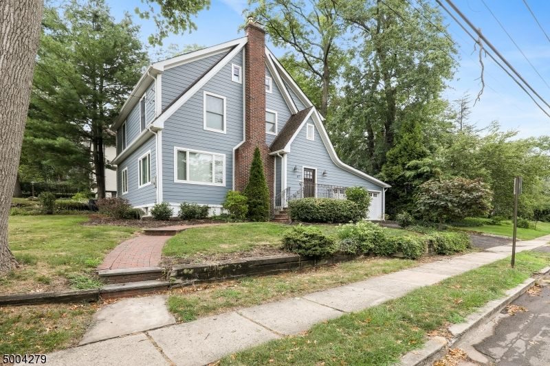 Enjoy this Millburn Tudor renovated 3 yrs ago. 1st fl open floor plan. LR w/wood burning FP w/stone surround/mantel, Dining Area & TV area + plus designer Kitchen. Granite counters (6' x 6' island), SS Dacor appliances & open to Den. Door in Den takes you to a paver patio. 2nd level has Master Bedroom en-suite w/large step-in closet. Another bedroom has a walk-in closet. Walk-up attic waiting to be finished (w/separate storage room). HW floors thru-out. Finished basement &interior access to 2-car garage. 2017 renovations/updates include: Kitchen, Bathrooms, roof, baseboard heat, CAC, most electric/plumbing, doors/windows, HardiePlank siding, front porch/steps.Across from elementary school & playground/ballfields. 1 mile to train station for Mid-Town Direct to NYC. Easy access to downtown shopping & highways.